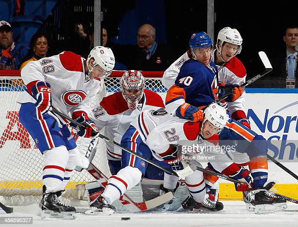 Michael Bournival, Carey Price, Josh Gorges and Lars Eller of the Montreal Canadiens defend against Michael Grabner of the New York Islanders during...
