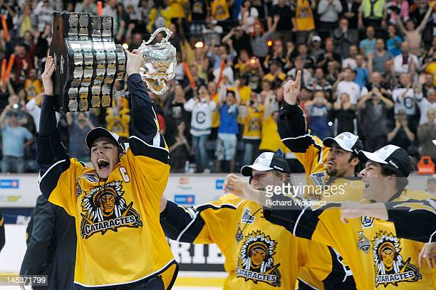 Michael Bournival of the Shawinigan Cataractes raises the Memorial Cup after defeating the London Knights during the 2012 MasterCard Memorial Cup...