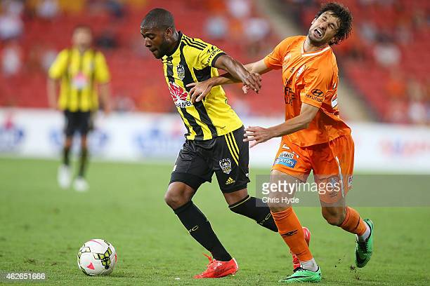 Michael Boxall of the Phoenix and Thomas Broich of the Roar compete for the ball the ball during the round 16 ALeague match between the Brisbane Roar...