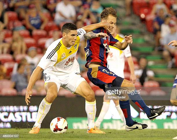 Michael Boxall of the Phoenix contests the ball against Adam Taggart of the Jets during the round 24 ALeague match between the Newcastle Jets and...