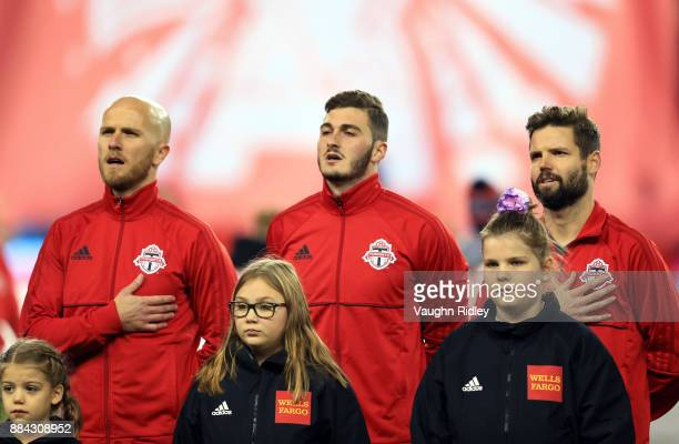 Michael Bradley Alex Bono and Drew Moor of Toronto FC sing the national anthem prior to the first half of the MLS Eastern Conference Finals Leg 2...