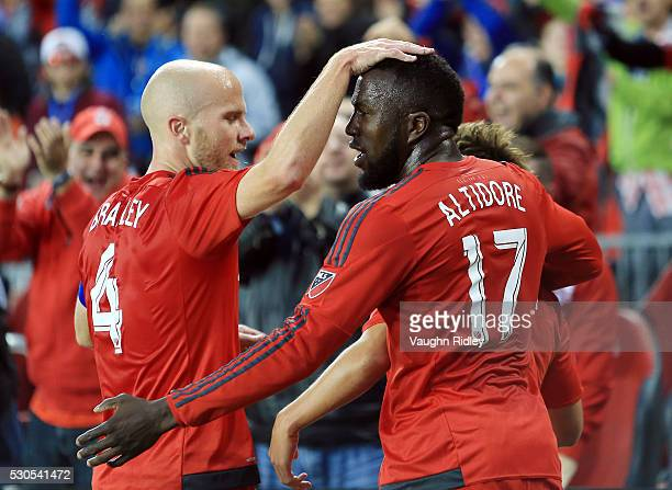 Michael Bradley and Jozy Altidore of Toronto FC celebrate a goal by teammate Tsubasa Endoh during the first half of an MLS soccer game against FC...