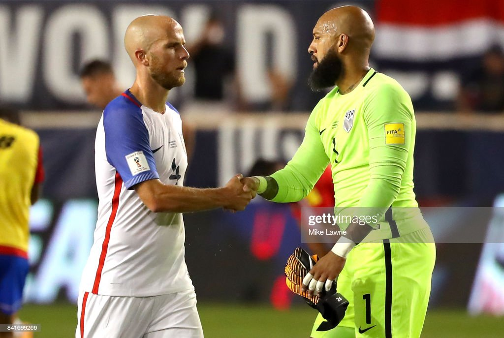 Michael Bradley #4 and Tim Howard #1 of the United States react after being defeated by Costa RicJohnny Acosta #2 of Costa Rica-0 during the FIFA 2018 World Cup Qualifier at Red Bull Arena on September 1, 2017 in Harrison, New Jersey.