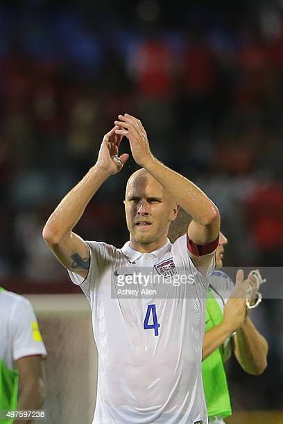 Michael Bradley captain of the USA national soccer team applauds the crowd and US section of support during a World Cup Qualifier between Trinidad...