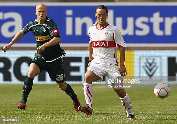 Michael Bradley of Gladbach challenges Mauro Camoranesi of Stuttgart during the Bundesliga match between VfB Stuttgart and Borussia Moenchengladbach...