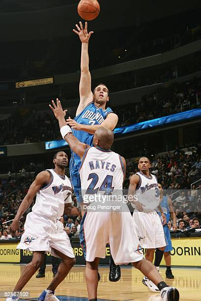Michael Bradley of the Orlando Magic shoots over Jarvis Hayes of the Washington Wizards during the game on November 10 2004 at the MCI Center in...