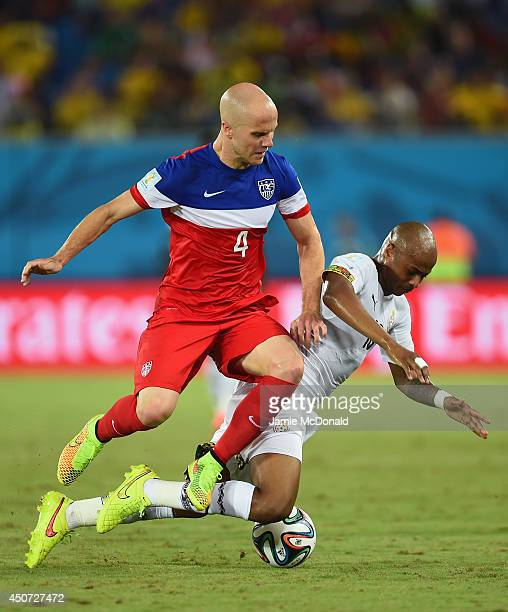 Michael Bradley of the United States and Andre Ayew of Ghana battle for the ball during the 2014 FIFA World Cup Brazil Group G match between Ghana...