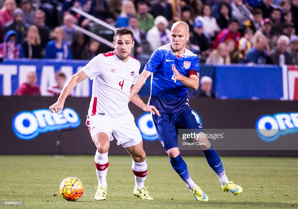 Michael Bradley #4 of the United States battles Doneil Henry #4 of Canada during the International Soccer Friendly match between the United States and Canada at the StubHub Center on February 5, 2016 in Carson, California. The United States won the match 1-0