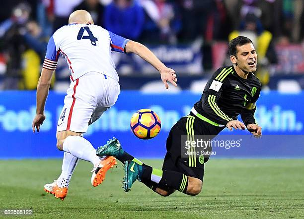 Michael Bradley of the United States battles for the ball against Rafael Marquez of Mexico in the second half during the FIFA 2018 World Cup...
