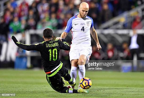 Michael Bradley of the United States dribbles the ball against Giovani Dos Santos of Mexico in the first half during the FIFA 2018 World Cup...