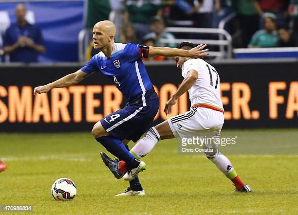 Michael Bradley of the United States moves the ball against Mario Osuna of Mexico during an international friendly match at the Alamodome on April 15...