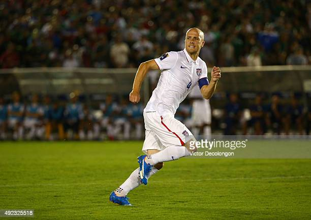 Michael Bradley of the United States paces the play on the attack against Mexico during the 2017 FIFA Confederations Cup Qualifying match at Rose...