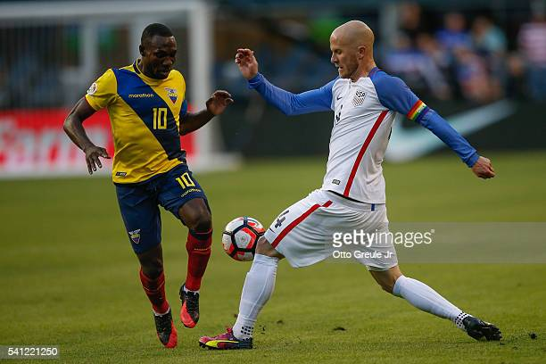 Michael Bradley of the United States wearing a rainbow armband in honor of the Orlando shooting victims battles Walter Ayoví of Ecuador during the...