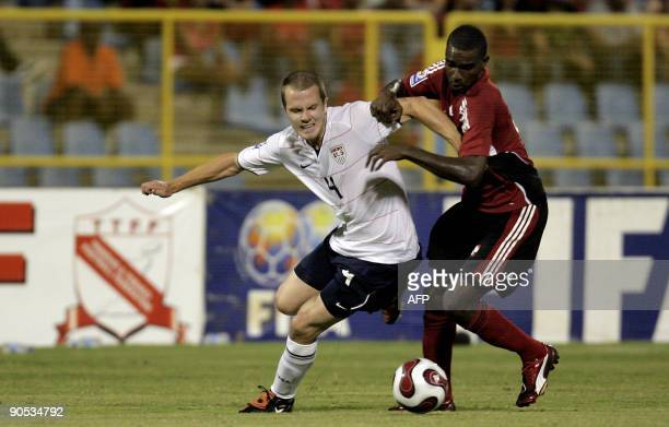 Michael Bradley of the US vies for the ball with Clyde Leon of Trinidad and Tobago during their FIFA World Cup South Africa-2010 qualifier football...