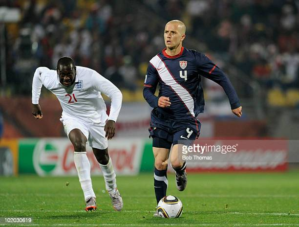 Michael Bradley of the USA chased by Emile Heskey of England during the 2010 FIFA World Cup South Africa Group C match between England and USA at the...