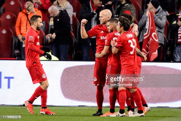 Michael Bradley of Toronto FC and other Toronto FC players celebrate a goal during the first half of the MLS Cup Playoffs match between Toronto FC...