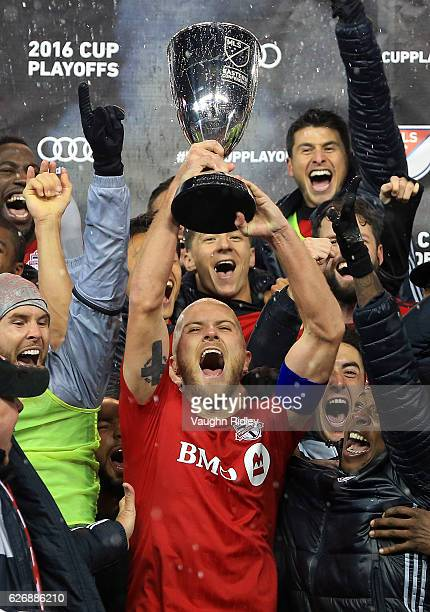Michael Bradley of Toronto FC and teammates celebrate with the Eastern Conference Trophy following the MLS Eastern Conference Final Leg 2 game...