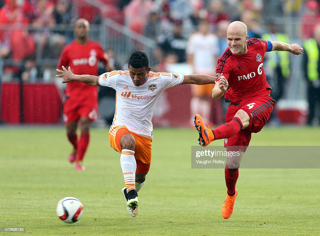 Michael Bradley #4 of Toronto FC battles with Luis Garrido #8 of the Houston Dynamo during an MLS soccer game between the Houston Dynamo and Toronto FC at BMO Field on May 10, 2015 in Toronto, Ontario, Canada.