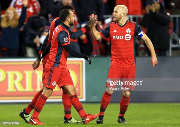 Michael Bradley of Toronto FC congratulates Jozy Altidore after his goal during the second half of the MLS Eastern Conference Finals Leg 2 game...