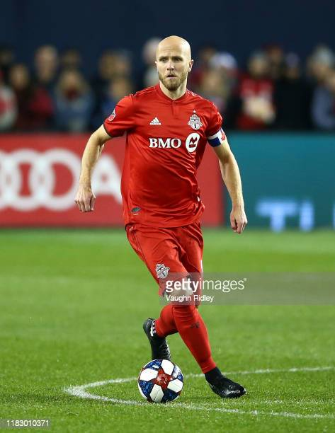 Michael Bradley of Toronto FC dribbles the ball during an MLS First Round Playoff game against DC United at BMO Field on October 19 2019 in Toronto...