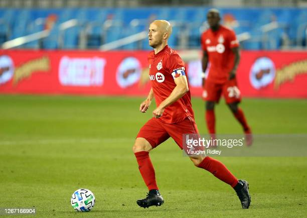 Michael Bradley of Toronto FC dribbles the ball during the first half of an MLS game against Vancouver Whitecaps FC at BMO Field on August 18 2020 in...