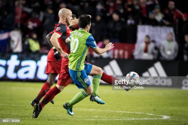 Michael Bradley of Toronto FC gets ahead of the ball against Nicolas Lodeiro of Seattle Sounders during the 2017 Audi MLS Championship Cup match...