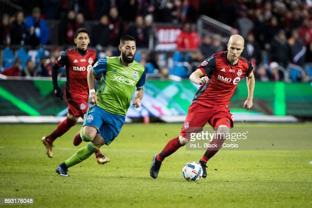 Michael Bradley of Toronto FC gives a touch to the ball against Clint Dempsey of Seattle Sounders during the 2017 Audi MLS Championship Cup match...