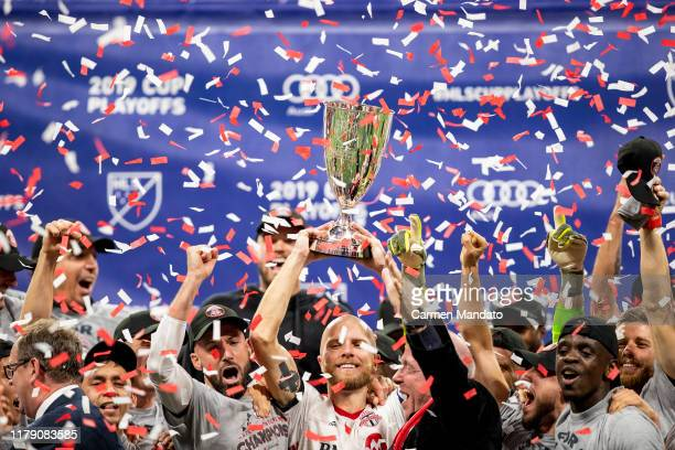 Michael Bradley of Toronto FC lifts the Eastern Conference trophy alongside teammates following the Eastern Conference Finals between Atlanta United...