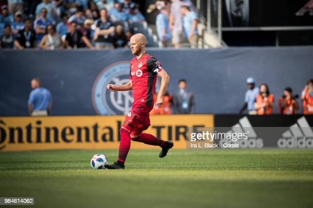 Michael Bradley of Toronto FC takes the ball across the pitch during the MLS match between New York City FC and Toronto FC at Yankee Stadium on June...