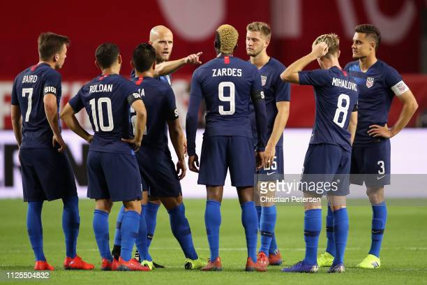 Michael Bradley of United States talks with teammates Cristian Roldan Gyasi Zardes and Djordje Mihailovic during the first half of the international...