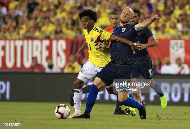 Michael Bradley of Unites States and Juan Cuadrado of Colombia fight for the ball during an International Friendly at Raymond James Stadium on...