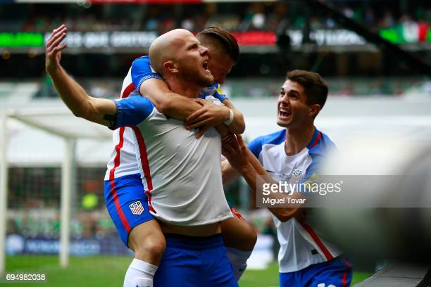 Michael Bradley of US celebrates with teammates after scoring the first goal of his team during the match between Mexico and The United States as...