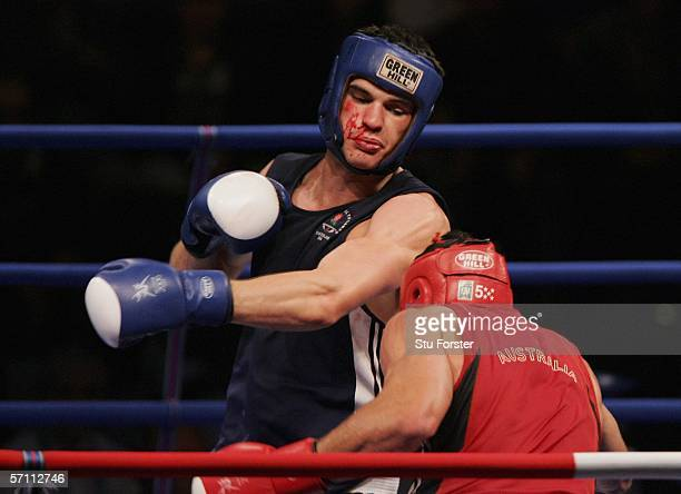 Michael Bradley Pitt of Australia and Anthony Daniel Price of England exchange blows during their boxing match at the Melbourne Exhibition Centre...