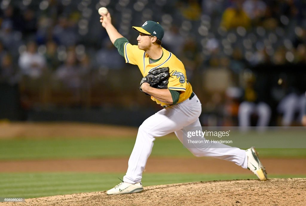Michael Brady #64 of the Oakland Athletics pitches against the Houston Astros in the top of the ninth inning at Oakland Alameda Coliseum on June 20, 2017 in Oakland, California. This was Brady's major league debut.