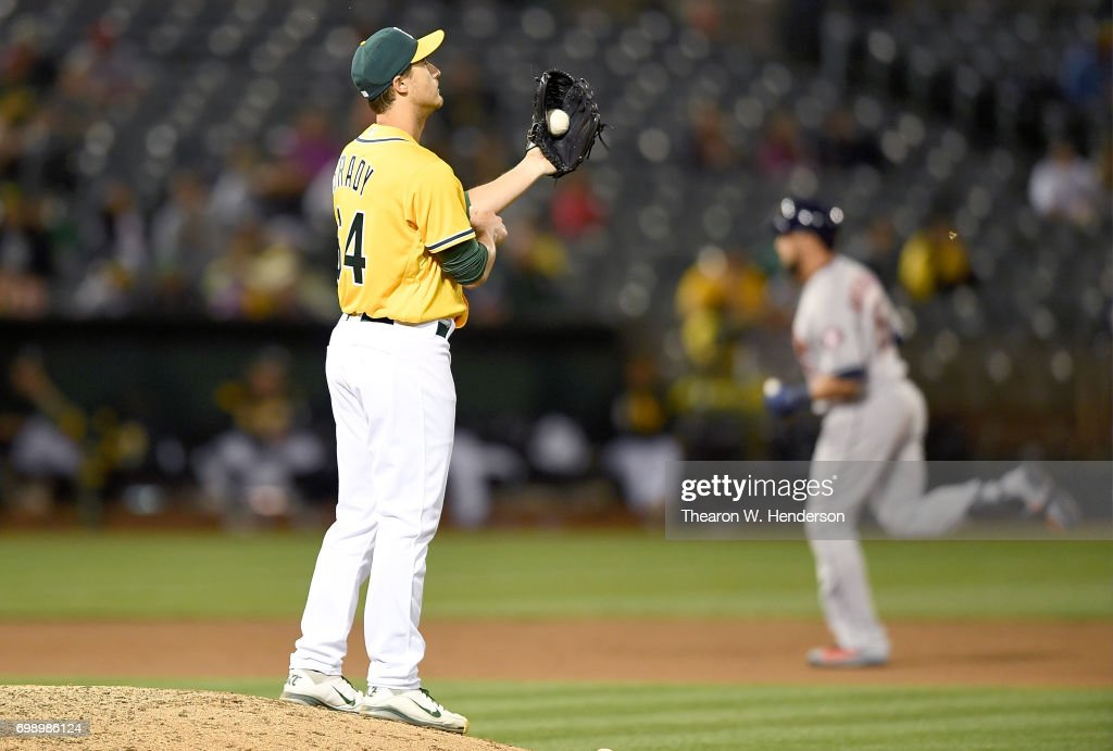 Michael Brady #64 of the Oakland Athletics reacts after giving up a solo home run to Carlos Beltran #15 of the Houston Astros in the top of the ninth inning at Oakland Alameda Coliseum on June 20, 2017 in Oakland, California. This was Brady's major league debut.