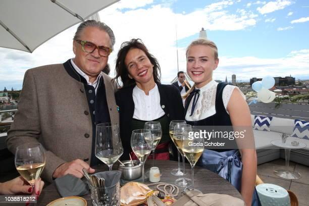 Michael Brandner and his wife Karin Brandner Jeanne Goursaud wearing a Dirndl by Amsel Fashion during the 'Amsel Fashion Wiesn Brunch' during the...