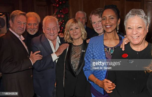 Michael Brandon Sir Tom Jones Johnny Gold Glynis Barber Bill Collins Hazel Collins and Jan Gold attend Tramp's Christmas Party in celebration of...