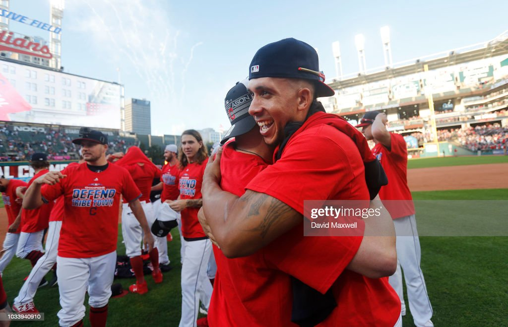 Michael Brantley #23 and Edwin Encarnacion #10 of the Cleveland Indians embrace during a post game celebration after the Indians defeated the Detroit Tigers 15-0 to clinch there American League Central Division Championship at Progressive Field on September 15, 2018 in Cleveland, Ohio.