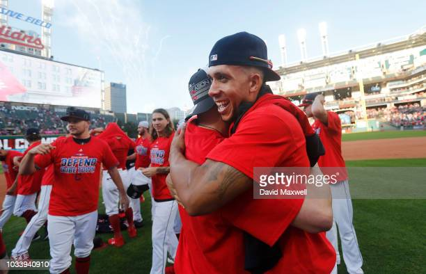 Michael Brantley and Edwin Encarnacion of the Cleveland Indians embrace during a post game celebration after the Indians defeated the Detroit Tigers...