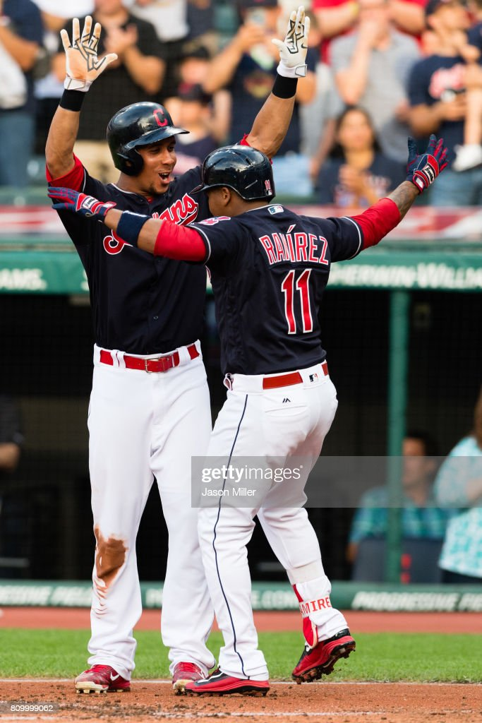 Michael Brantley #23 celebrates with Jose Ramirez #11 of the Cleveland Indians after both scored on a two run home run by Ramirez during the first inning against the San Diego Padres at Progressive Field on JULY 6, 2017 in Cleveland, Ohio.