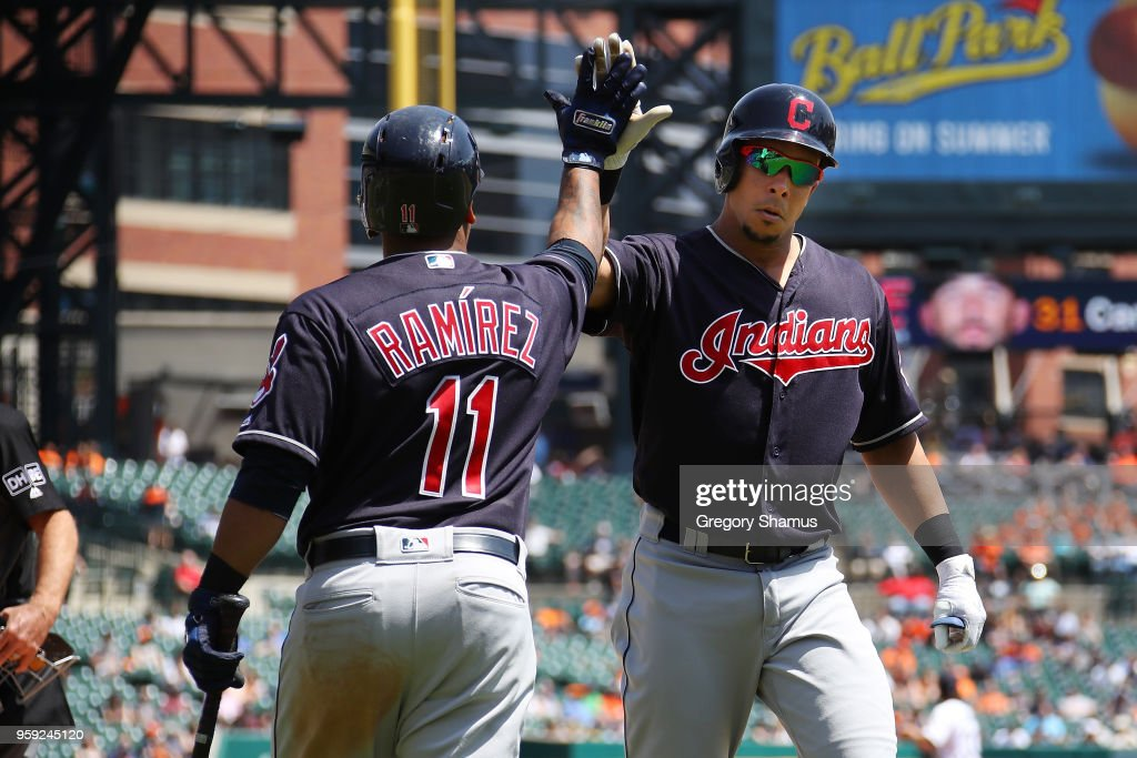 Michael Brantley #23 of the Cleveland Indians celebrates his solo home run in the fifth inning with Jose Ramirez #11 while playing the Detroit Tigers at Comerica Park on May 16, 2018 in Detroit, Michigan.