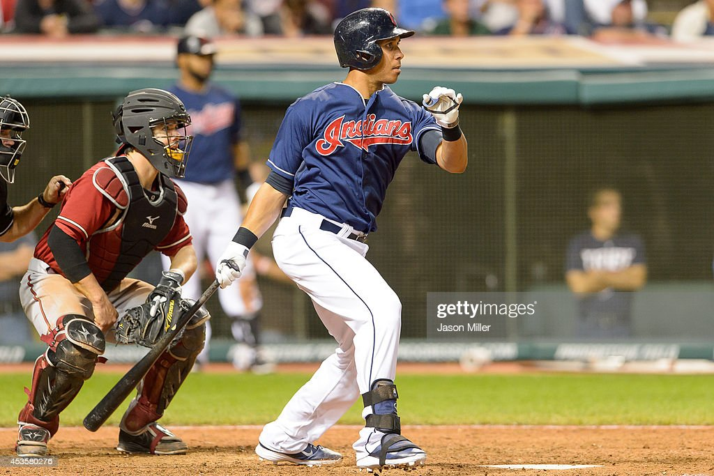 Michael Brantley #23 of the Cleveland Indians hits a single during the eighth inning against the Arizona Diamondbacks at Progressive Field during the second game of a double header on August 13, 2014 in Cleveland, Ohio.