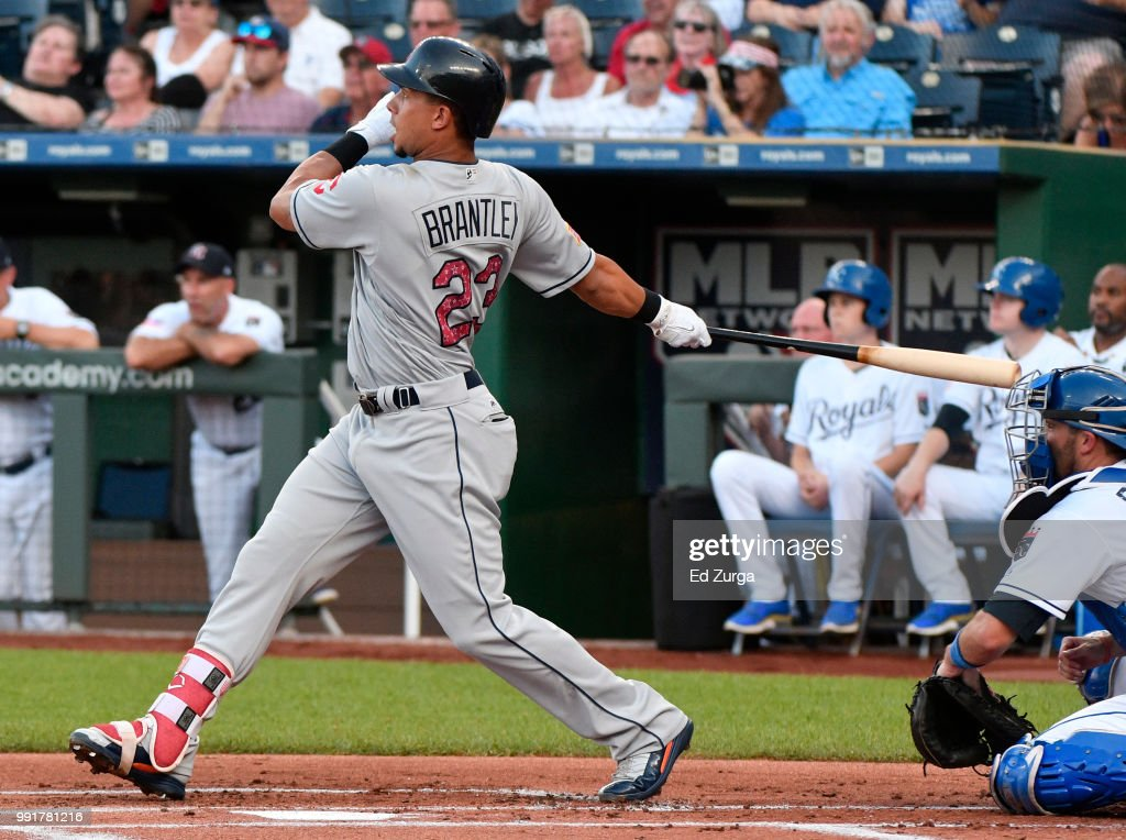Michael Brantley #23 of the Cleveland Indians hits an RBI double in the first inning against the Kansas City Royals at Kauffman Stadium on July 4, 2018 in Kansas City, Missouri.