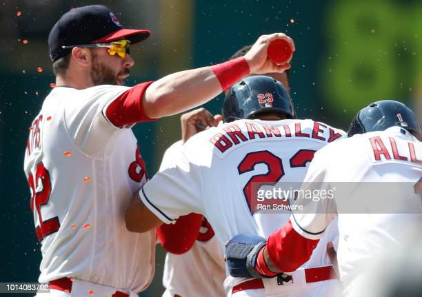 Michael Brantley of the Cleveland Indians is mobbed by Jason Kipnis and Greg Allen after hitting a game winning single off Addison Reed of the...