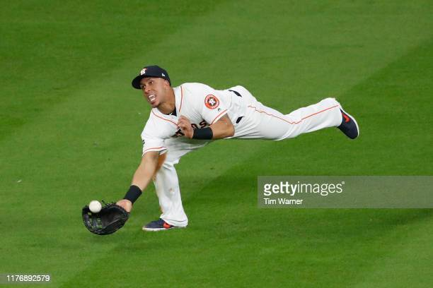 Michael Brantley of the Houston Astros makes a diving catch in the seventh inning against the New York Yankees during Game Six of the League...
