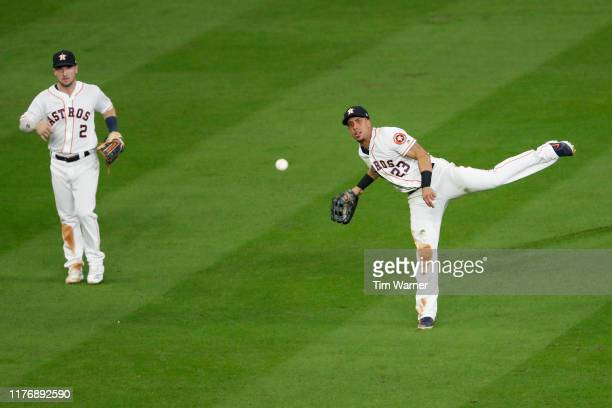 Michael Brantley of the Houston Astros throws to first to complete a double play in the seventh inning against the New York Yankees during Game Six...