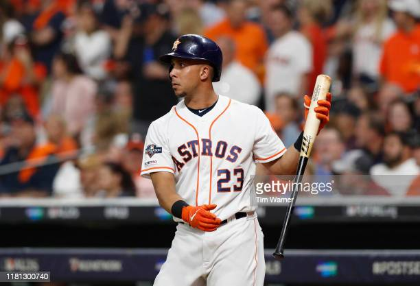 Michael Brantley of the Houston Astros warms up on deck in the eighth inning against the Tampa Bay Rays during game five of the American League...