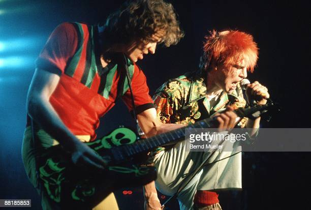 Michael Breitkopf and Campino of German punk band Die Toten Hosen perform on stage at the Stadthalle in Furth Germany in April 1989