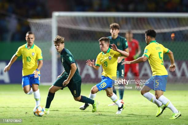 Michael Brentan of Italy looks to break past Pedro Lucas of Brazil and Daniel Cabral of Brazil during the FIFA U17 World Cup Quarter Final match...