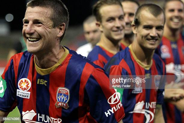 Michael Bridges celebrates the win with teammates cheering him on during his last game during the round 27 ALeague match between the Newcastle Jets...